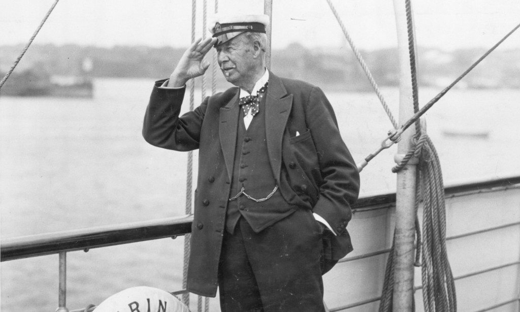 Original Caption: Newport, RI- Sir Thomas Lipton and his Challenger, Newport bound. Photo shows Sir Thomas Lipton aboard his yacht, Erin, which conveyed the Shamrock V to Newport, RI, the scene of her trials and eventual meeting with the United States yacht in the American Cup Match. Photo shows Lipton on deck saluting. Undated photograph circa 1920.